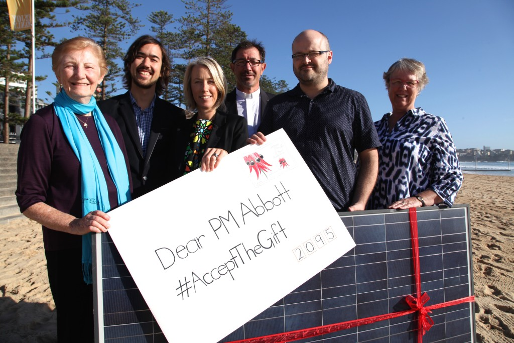 May 2015: Catholic Earthcare Director Jacqui Remond (third from left), with the group Common Grace, gifting Solar Panels to Tony Abbott.