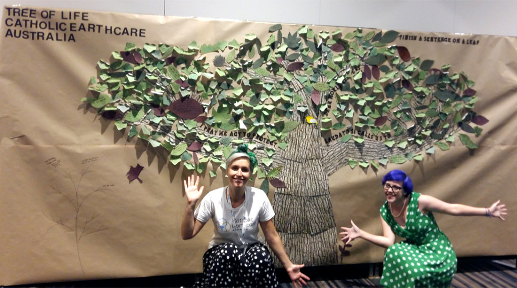 Katie McSweeney (left) and Tess Corkish (right) with their Tree of Life at the Australian Catholic Youth Festival